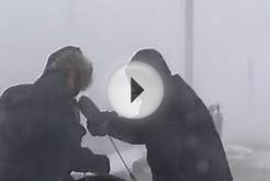 Reporters blown off-camera during live blizzard update