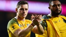 Wallabies first five-eighth Bernard Foley applauds the crowd at Twickenham.